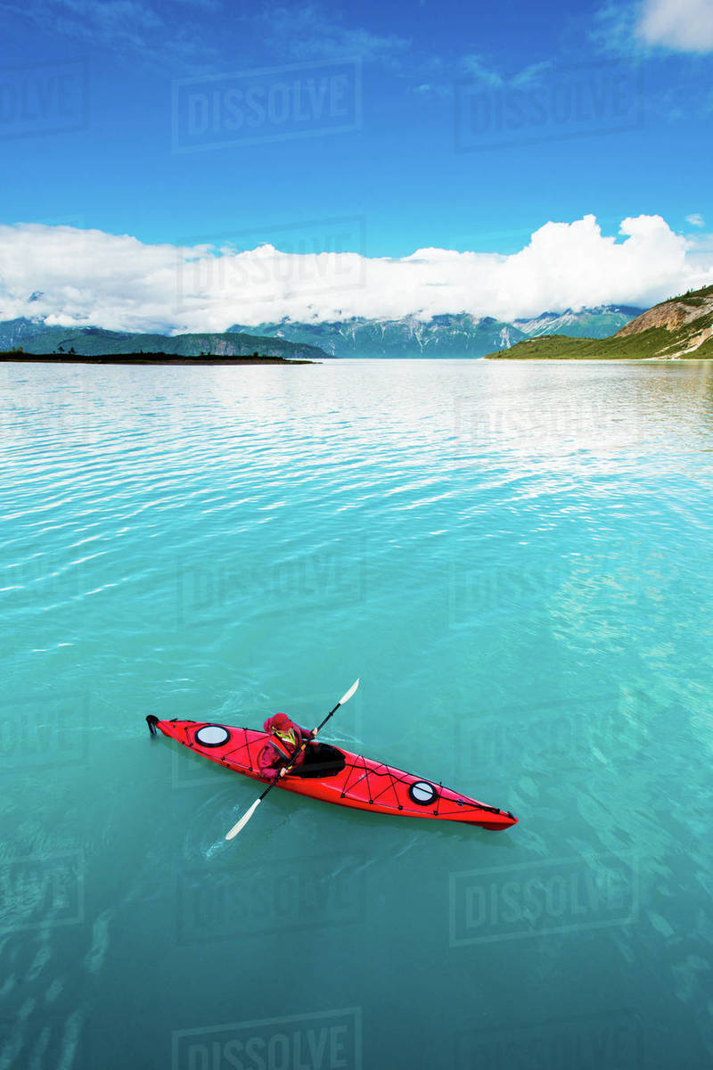 Woman kayaking in Glacier Bay National Park with blue water Royalty-free stock photo