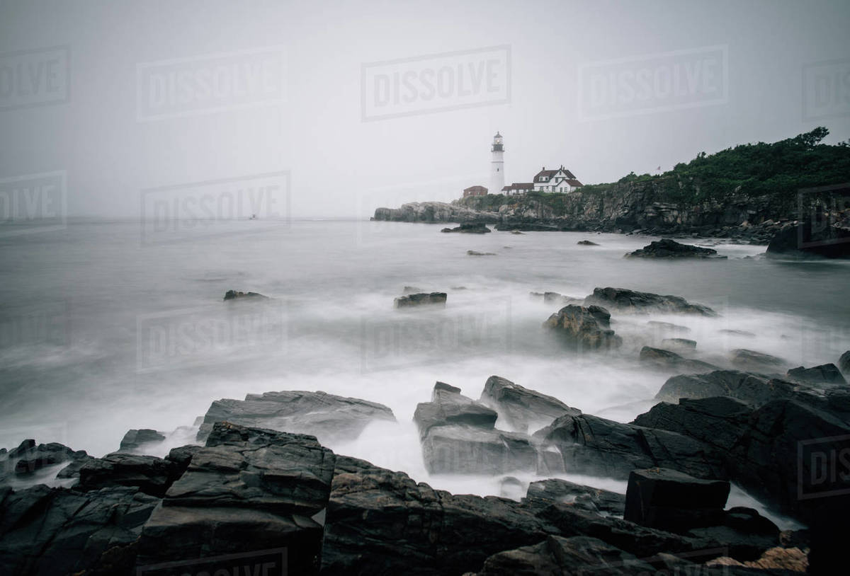 Foggy morning off the shore of Maine with the Portland Head Light Royalty-free stock photo