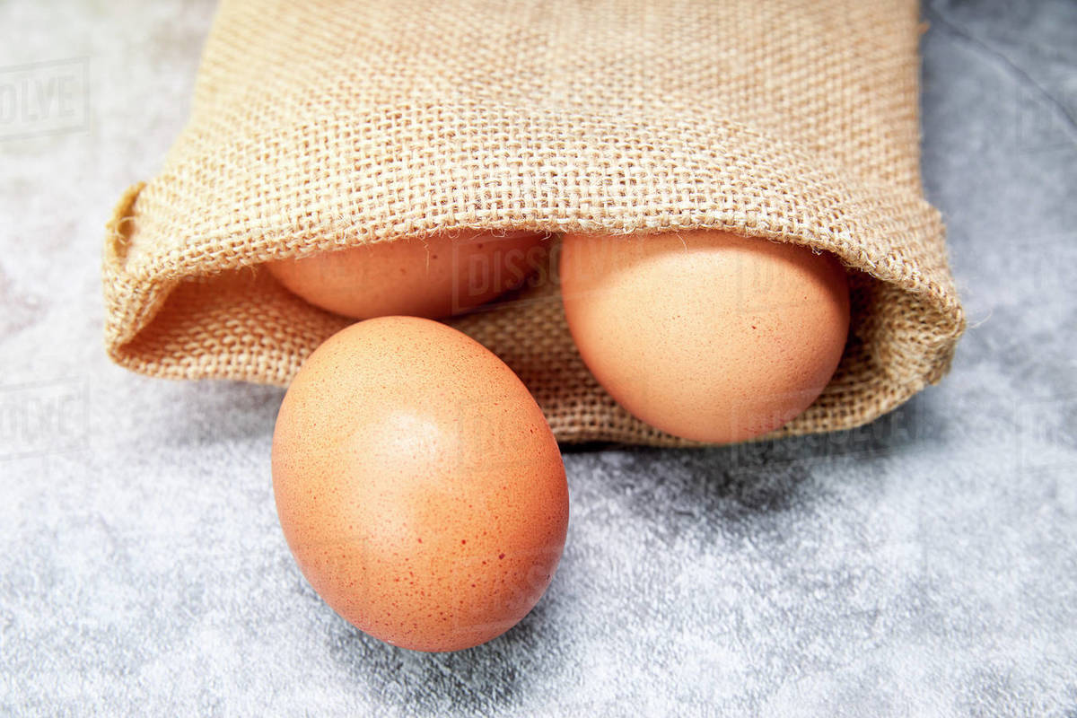 Chicken eggs in a raffia bag. Healthy food concept Royalty-free stock photo