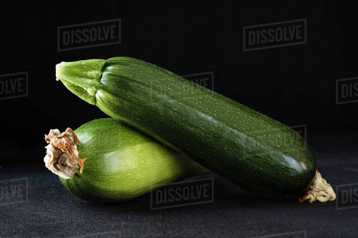 Garden fresh zucchini with dried blossoms attached Royalty-free stock photo