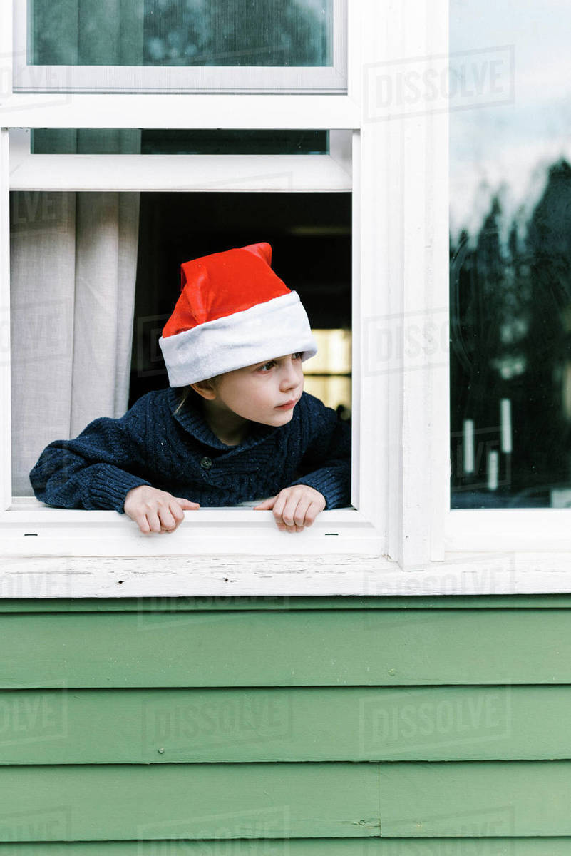 Little boy looking out window waiting for Santa clause on Christmas Royalty-free stock photo