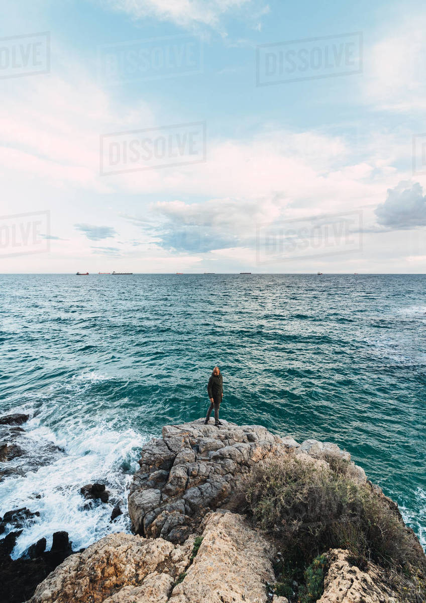Epic Shot Of A Man In The Center Of A Landscape Facing The Sea Royalty-free stock photo
