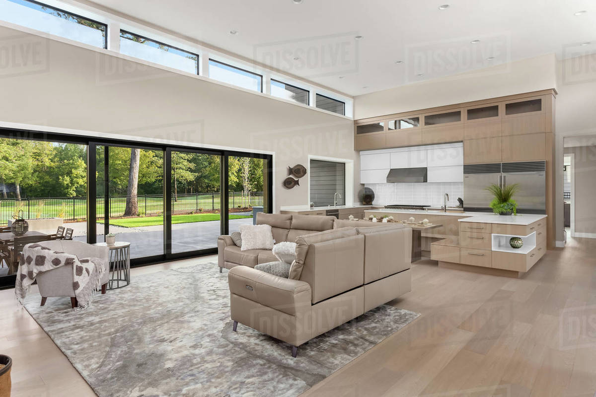 Living room and kitchen in new contemporary style luxury home Royalty-free stock photo