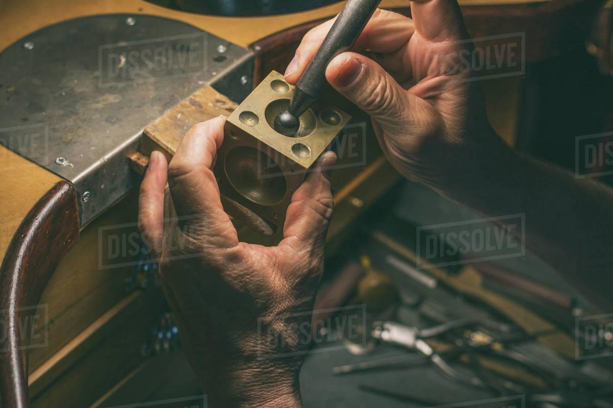 Hands of an artisan jeweler working jewelry. Jewelry Goldsmith Royalty-free stock photo