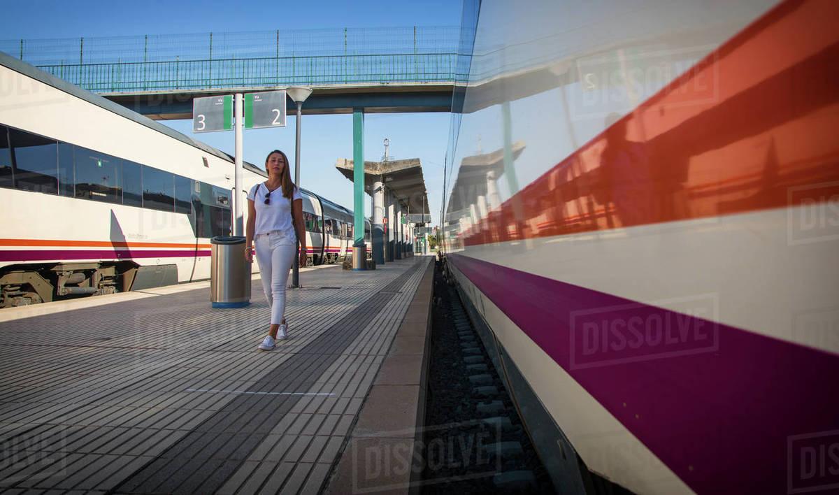 Woman Walking Through A Railway Station. Travels. Royalty-free stock photo