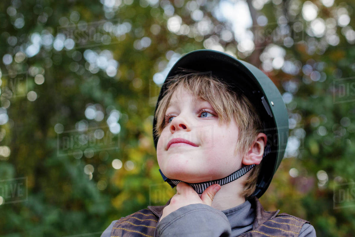 Close-up of a smiling boy in a soldier costume in sunlight Royalty-free stock photo