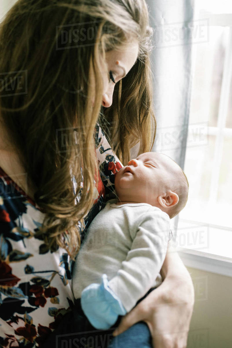 Mother looking at her sleeping newborn baby boy Royalty-free stock photo