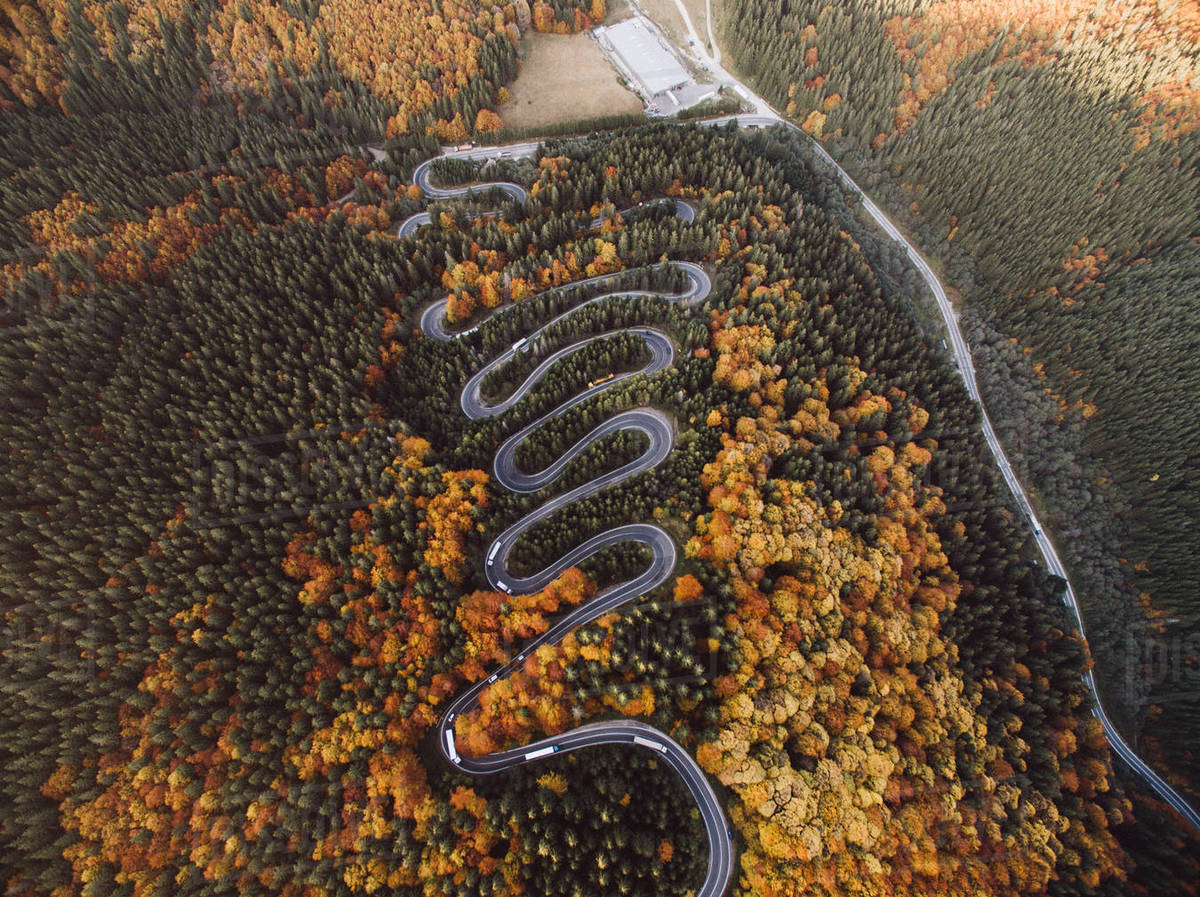 Aerial View of a Winding Road and Cars During Autumn Royalty-free stock photo