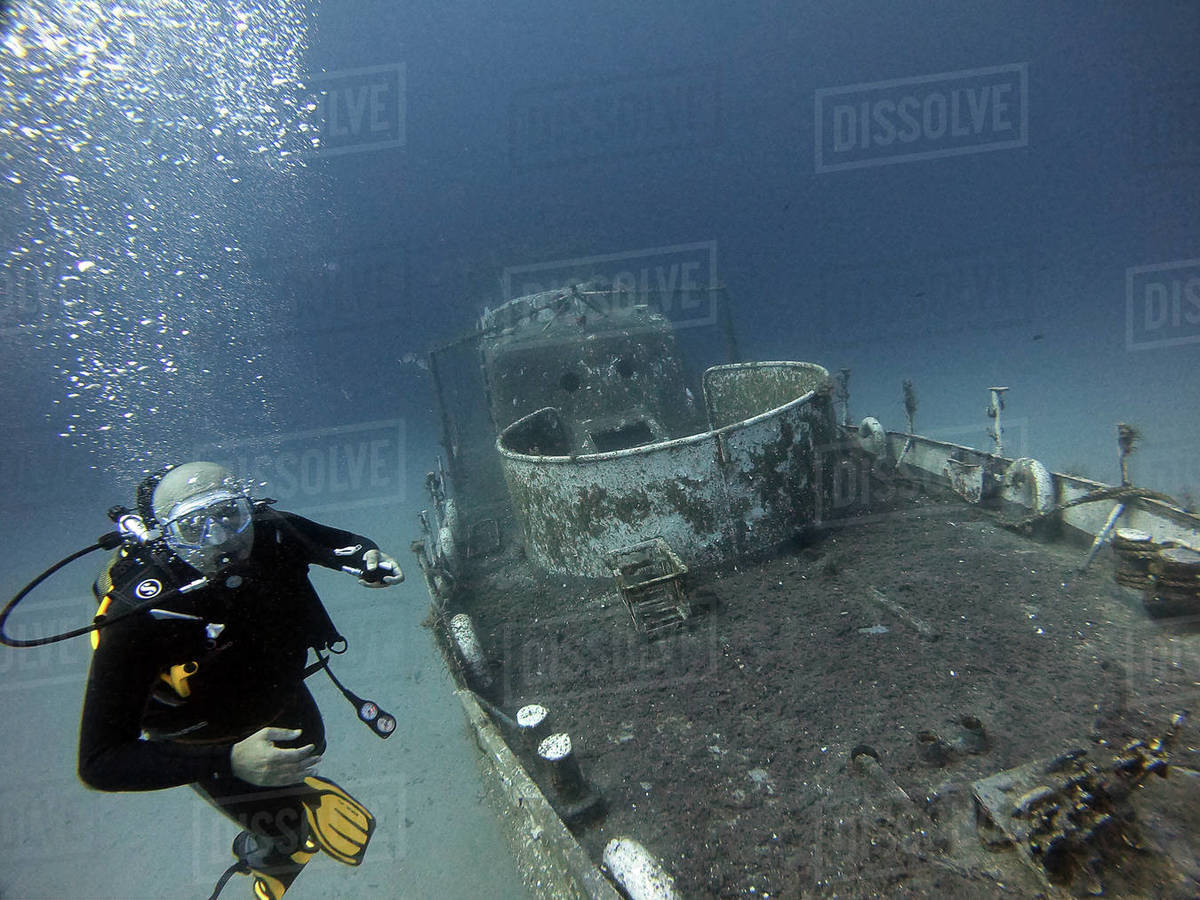 A diver dives next to the wreck in Antalya Turkey Royalty-free stock photo