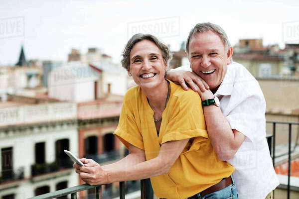 Portrait of happy senior couple standing on terrace Royalty-free stock photo