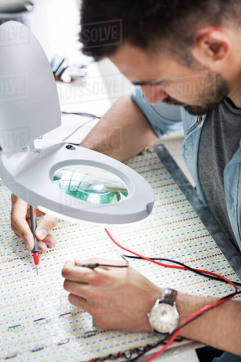 Engineer Soldering Circuit Board Using Magnifying Glass In Wiring Nail Electronics Industry