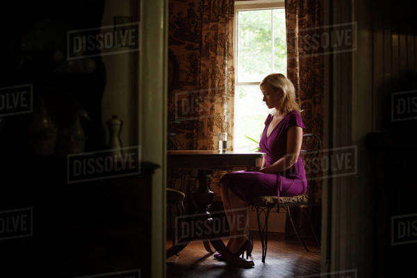 Woman sitting alone at home Royalty-free stock photo
