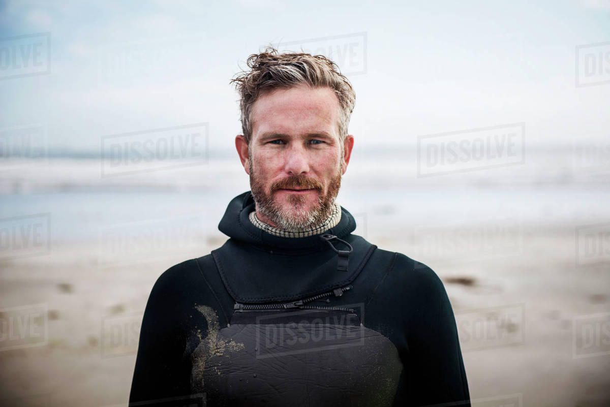 Portrait of confident surfer standing at beach Royalty-free stock photo