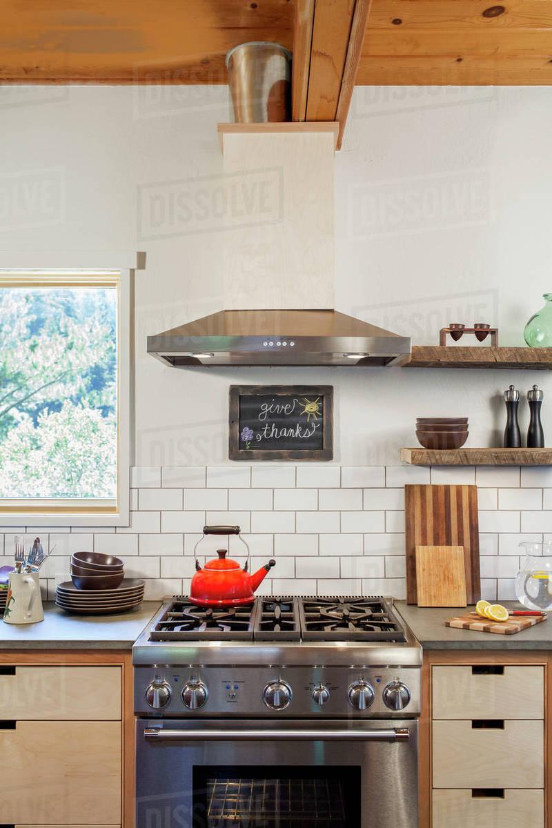 Tea Kettle On Stove In Kitchen Counter