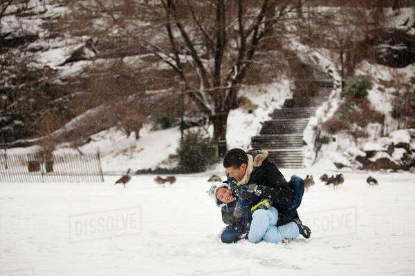 Father with daughter (4-5) playing in park in winter Royalty-free stock photo