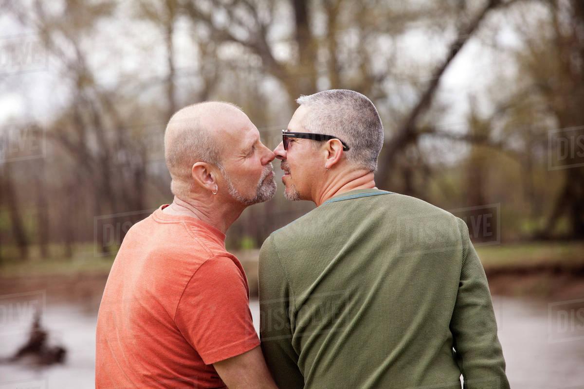 couple kissing at lake - stock photo - dissolve