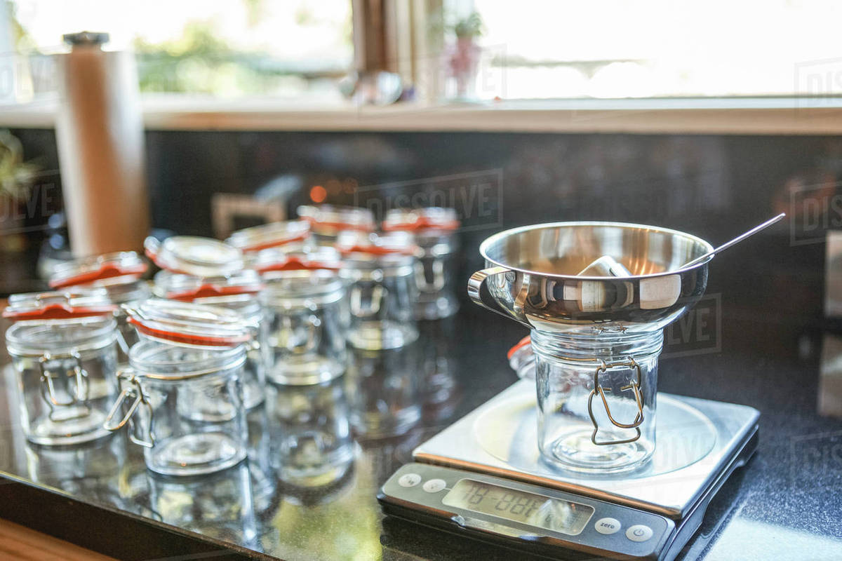 Weight Scale By Empty Mason Jars At Kitchen Counter