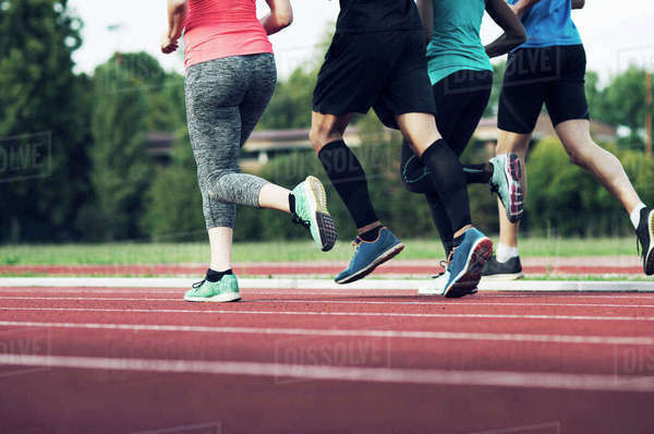 Low section of runners practicing on track Royalty-free stock photo