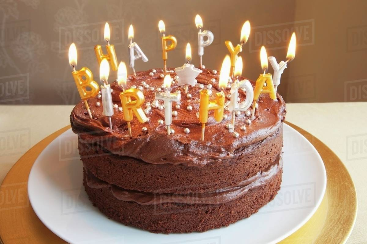 Peachy A Chocolate Birthday Cake With Lots Of Candles Stock Photo Funny Birthday Cards Online Hendilapandamsfinfo