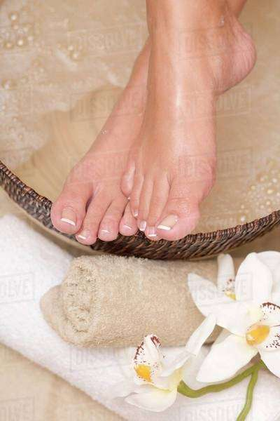 Woman enjoying a soothing foot bath Royalty-free stock photo