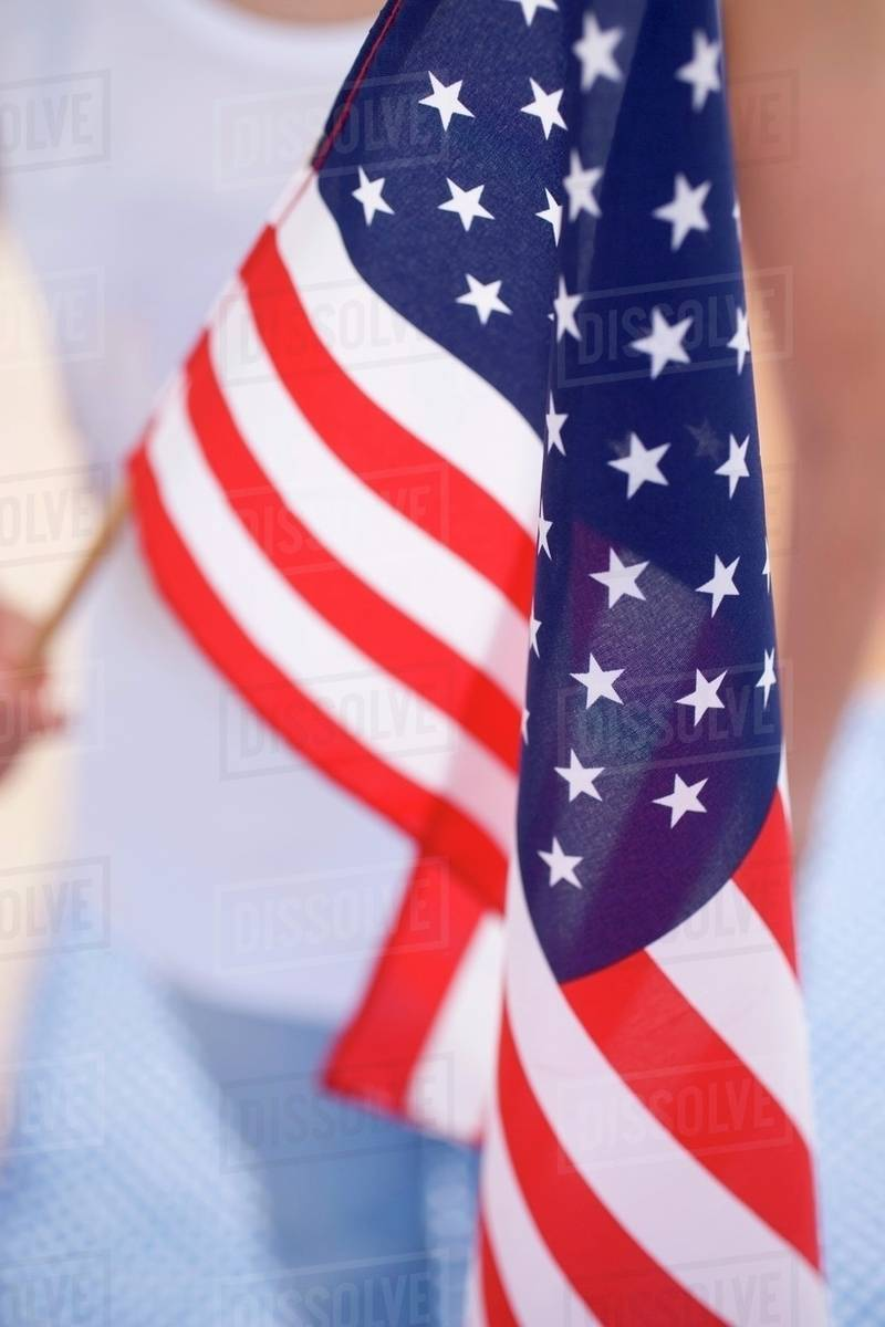 Woman Holding American Flag 4th Of July Usa Stock Photo Dissolve