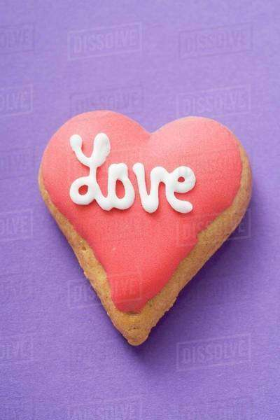 Heart-shaped biscuit with the word Love for Valentine's Day Royalty-free stock photo