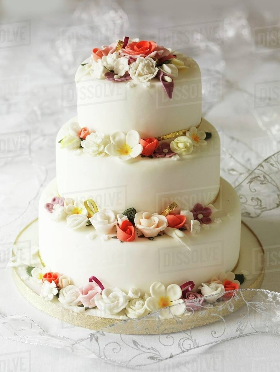 Three Tear Wedding Cakes.Three Tier Wedding Cake With Fondant Flowers Stock Photo