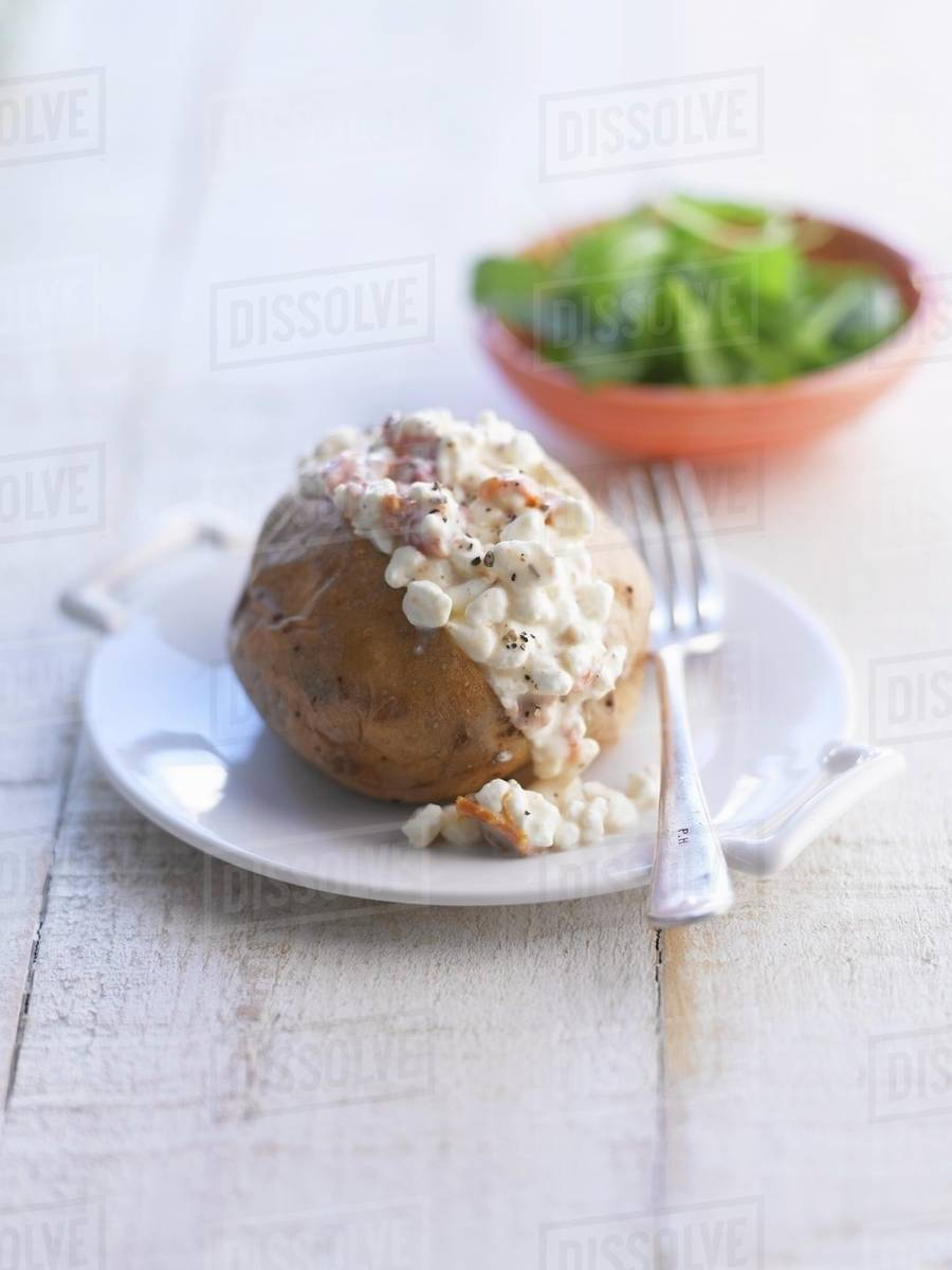 Astonishing A Baked Potato With Cottage Cheese Stock Photo Interior Design Ideas Gentotryabchikinfo