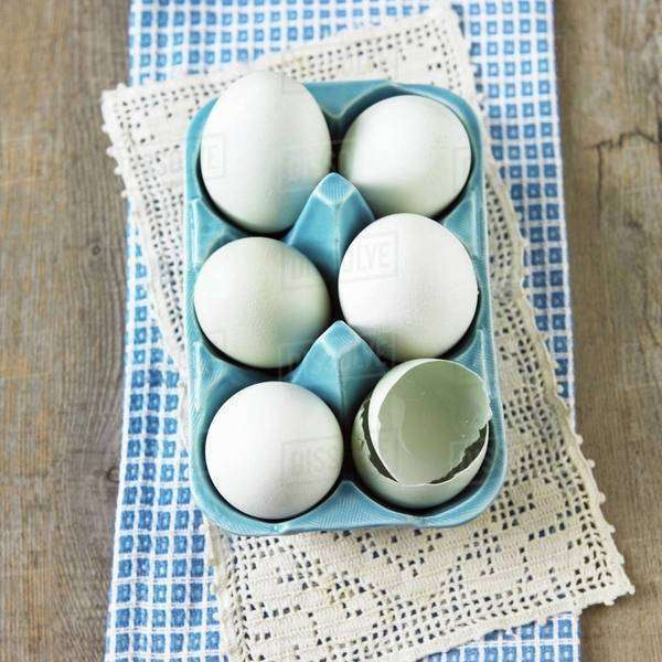Six American Hen Eggs in an Egg Carton; One Broken; From Above Royalty-free stock photo