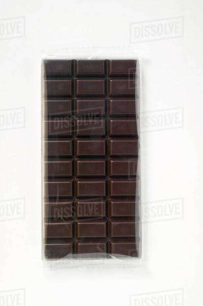 A bar of dark chocolate in cellophane Royalty-free stock photo