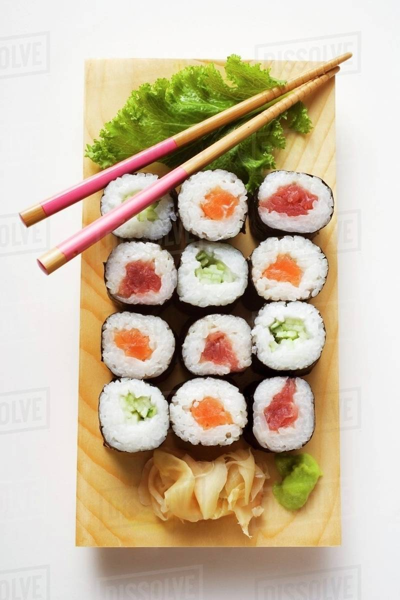 Maki sushi with fish and cucumber on sushi board Royalty-free stock photo