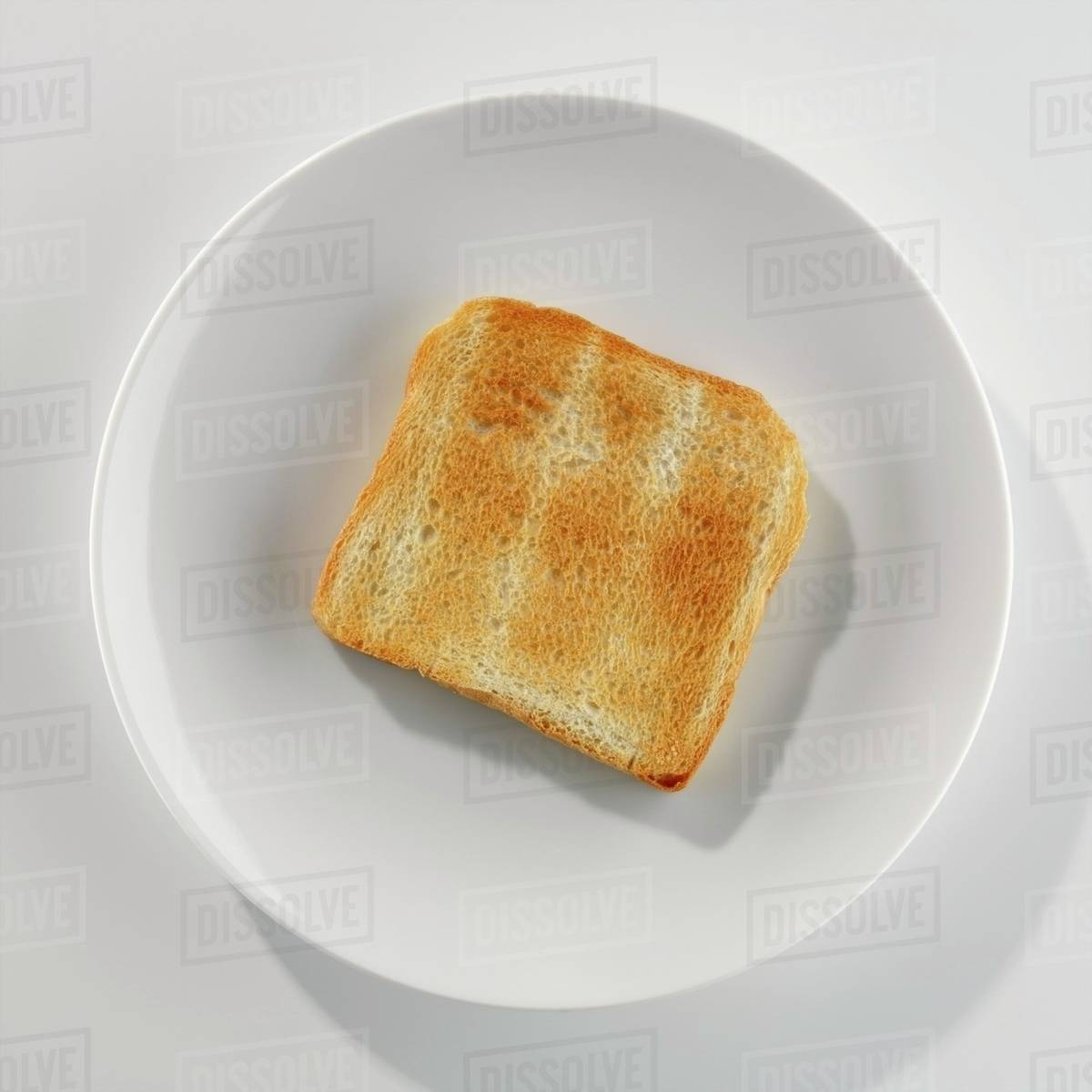 a slice of toast on a plate stock photo dissolve