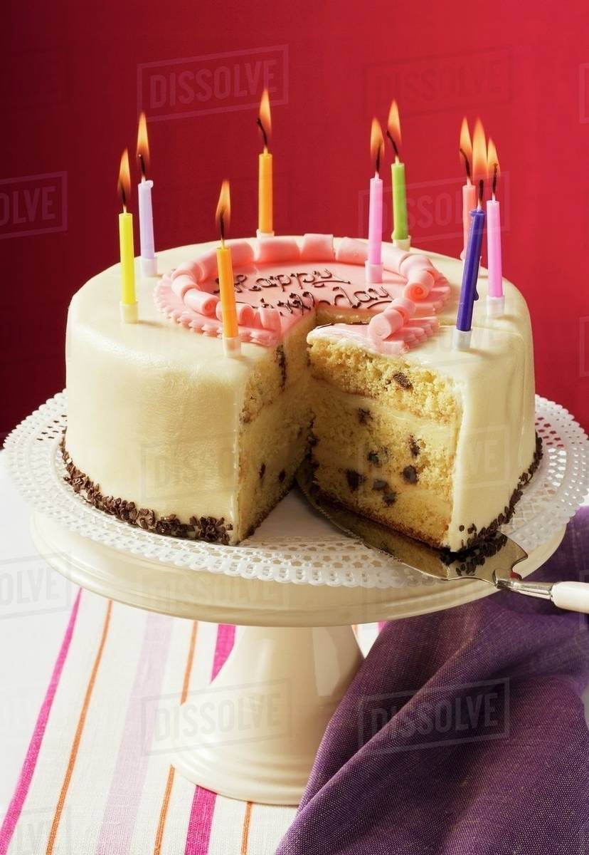 Birthday Cake With Burning Candles A Piece Cut