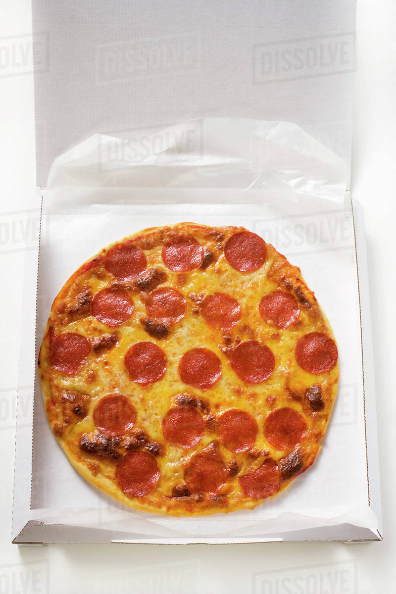 Whole salami and cheese pizza in pizza box Royalty-free stock photo