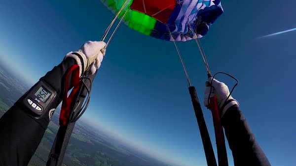 Skydiver is  opening parachute, view from helmet Royalty-free stock video