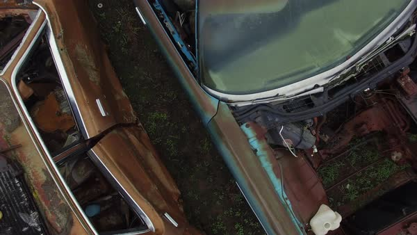 Wide shot over car wrecks in a junkyard Royalty-free stock video