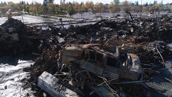 An aerial shot of burnt remains of a car after the Tubbs Fire at Santa Rosa, California Royalty-free stock video