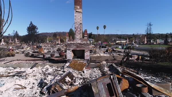 An aerial shot of burnt remains of houses and cars after the Tubbs Fire at Santa Rosa, California Royalty-free stock video
