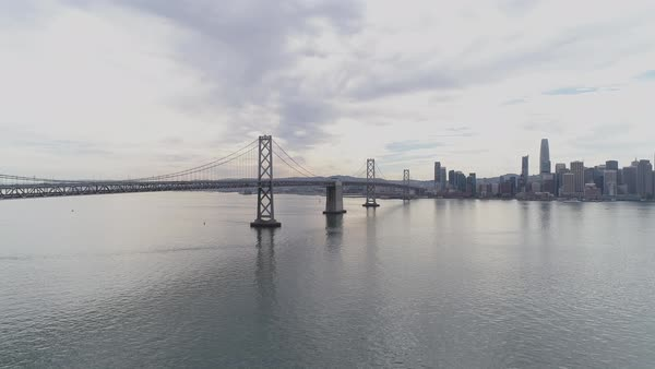Aerial shot of San Francisco–Oakland Bay Bridge with city in background Royalty-free stock video