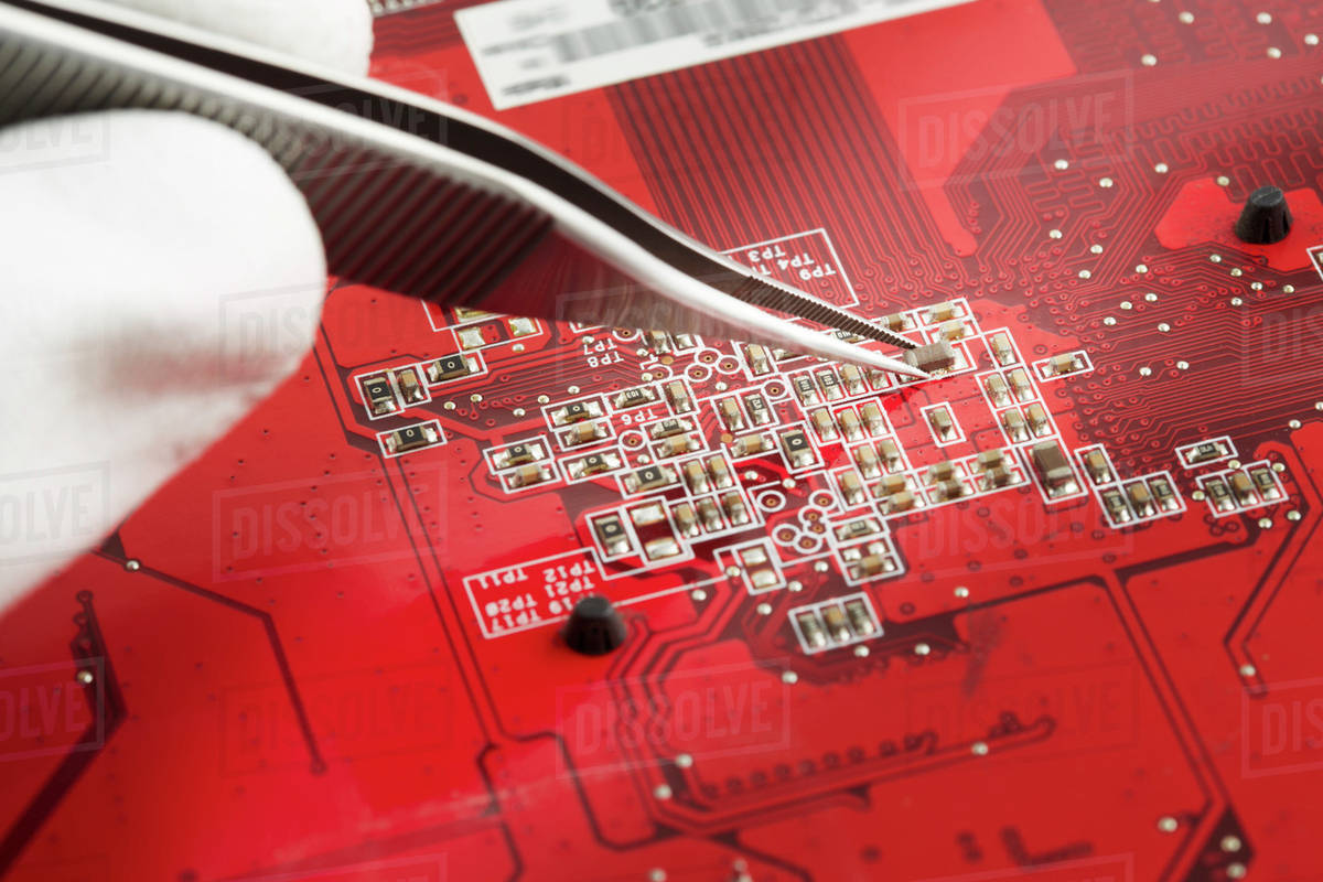 Human Hand Repairing Printed Circuit Board Close Up Stock Photo Detail Of A Royalty Free Image