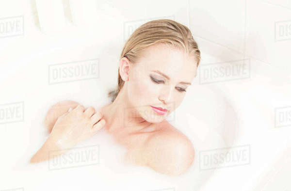 Young woman relaxing in milk bath Rights-managed stock photo