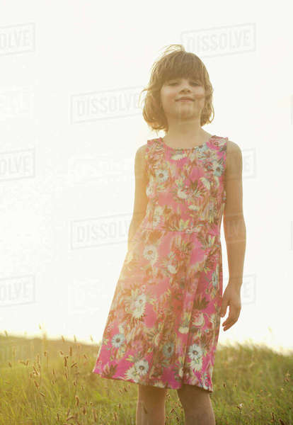 Portrait of confident girl wearing dress with floral design Rights-managed stock photo