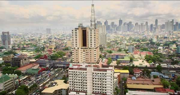 Dramatic aerial of Manila with slums in the foreground and Makati downtown high rises and skyscrapers in the background Royalty-free stock video