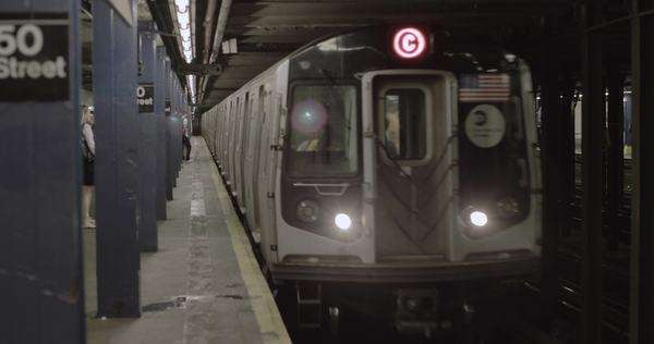 Handheld shot of the C train arriving to a station in New York City Royalty-free stock video