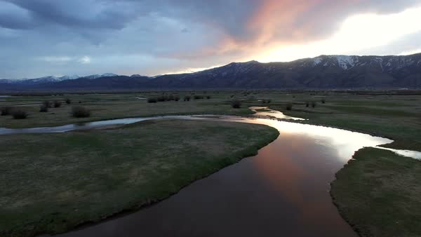 Panning view from drone of sunrise over river in Wyoming. Royalty-free stock video