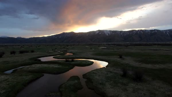 Flying view over river from drone at sunrise in Wyoming. Royalty-free stock video