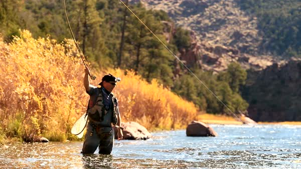 Man catches fish with fly rod on the Green River Royalty-free stock video