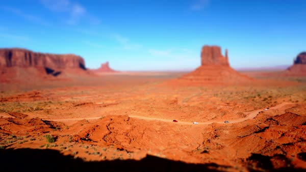 Tilt shift timelapse of cars driving a dirt road in Monument Valley Royalty-free stock video
