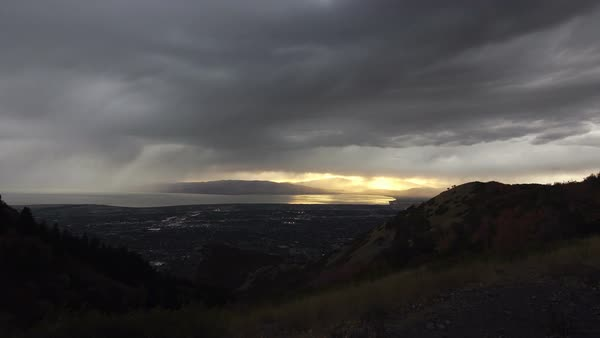 Storm working across valley as lightning strikes as the rain follows in Utah Royalty-free stock video