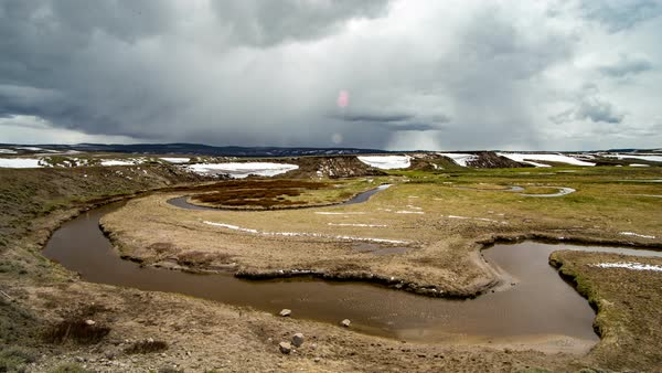 Timelapse of clouds moving over winding river in Hayden Valley Yellowstone Royalty-free stock video